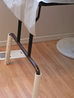 pvc pipe to make table taller.♥ It really works! great for bar area.