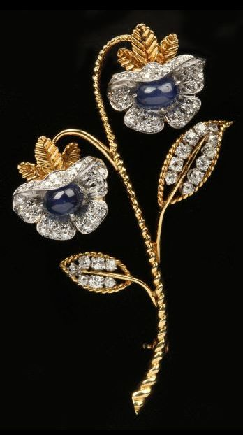 """Sapphire and Diamond Brooch, Van Cleef & Arpels exquisitely designed in a floral double blossom motif set with sapphire cabochons and accented with 83 single and Old European cut diamonds prong and bead set in platinum, completed with a double hinged pin stem. Signed """"Van Cleef & Arpels / #29680. Stamped 18KT and platinum.                                                                                                                                                     More"""