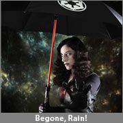 Obi Wan lightsaber umbrella?  Well, I wouldn't lose it, that's for sure... GIMME! =D