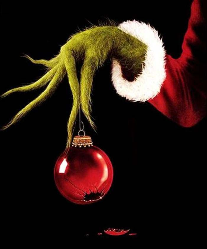 Grinch hand with broken ornament