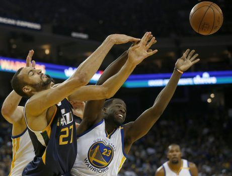 Golden State Warriors' Draymond Green (23) and Utah Jazz' Rudy Gobert (27) battle for a rebound in the second quarter of their game at Oracle Arena in Oakland, Calif., on Monday, April 10, 2017. (Jane Tyska/Bay Area News Group)