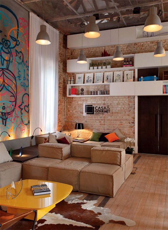 Combination of brick, selected splashes of color, wood floors