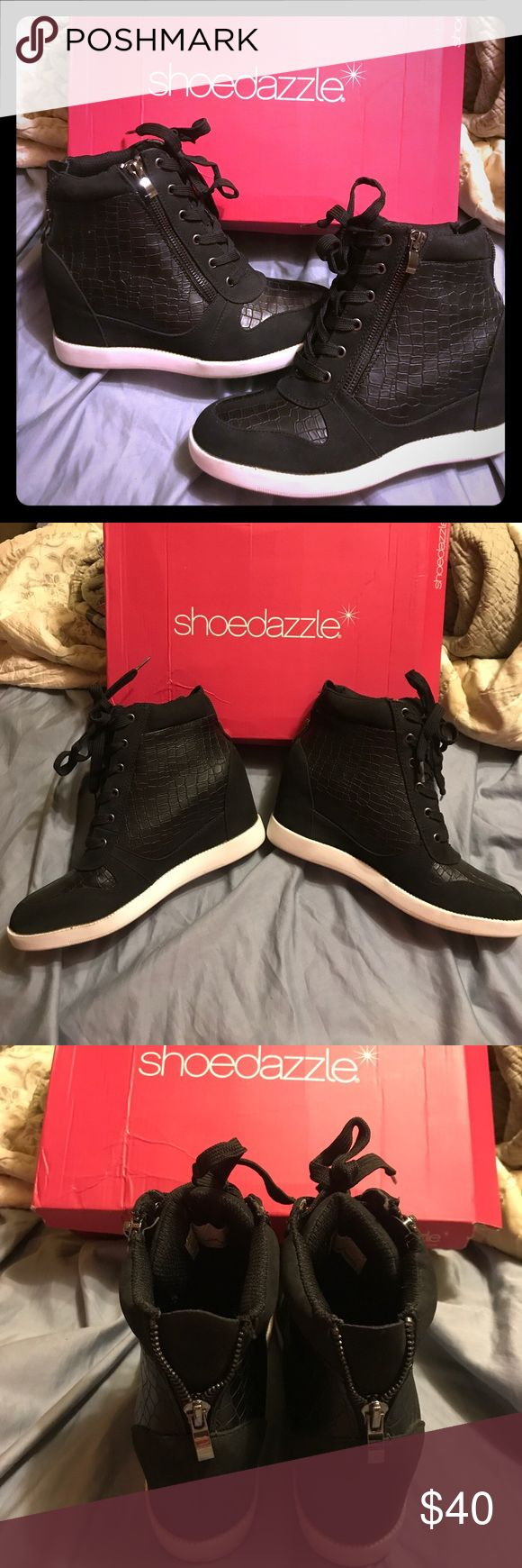 Show dazzle hidden wedge sneakers, size 7.5, new Show dazzle sneakers black snake like patterns has zip up sides and laces in front, very nice new but worn once, is recommend them for a size 7 instead of 7.5 as they were a little tight for me which is why I only wore them once,no flaws, bottom of souls a little dirty from wearing them once, box was damaged when delivered to me🚬🐱🏡💖accepting reasonable offers💖 Shoe Dazzle Shoes Sneakers