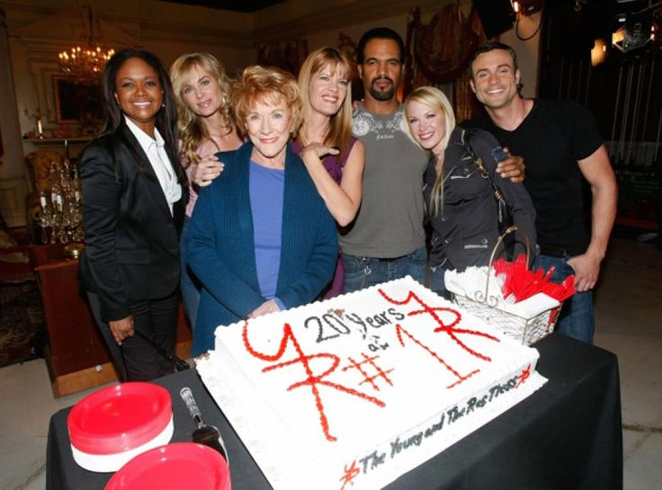 Cast members of 'The Young and the Restless' -- from l.,  actors Tonya Lee Williams, Eileen Davidson, Jeanne Cooper, Michelle Stafford, Kristoff St. John, Adrienne Frantz and Daniel Godbard -- celebrate their show's milestone of  staying the number one rated daytime drama series for twenty years during a Dec. 2008 ceremony in Hollywood.
