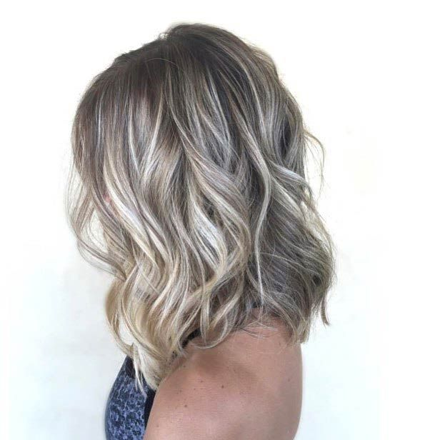 Ash Blonde Babylights Lob: This lob is effortlessly chic. If you like the ash blonde trend, try it out with some babylights. Adding this kind of highlights will make your hair look healthier and more radiant.