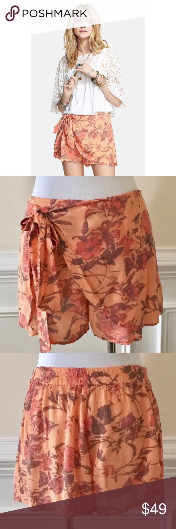 "New Free People Printed Sarong Short Cute shorts! Features a floral pattern, smocked elastic back waistband, flounce shorts and sarong skirt overlay with adjustable sash.  Tags in store to prevent returns.  Fabric tag is in Japanese. Imported Machine wash cold 100% Rayon 3"" inseam F690P981 Free People Shorts"