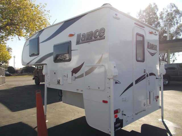 2016 New Lance 650 Truck Camper in California CA.Recreational Vehicle, rv, This little Lance Camper has what you need for a great Camping or Fishing Trip..Some of the Features Include: Electric Jacks w/wireless Remote Control, Air Conditioner, Entry Steps (4) Scissor, Exterior Propane Connection, Fantastic Roof Vent, 2-Burner Cooktop, Water Heater (tankless), 3- Way Fridge (3 cu ft), Exterior 110V Patio Outlet, Exterior Wash Station, AM/FM/DVD Stereo w/ Int & Ext Speakers (Bluetooth), Deluxe…