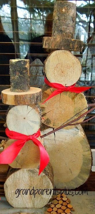 Log snowman~ We live in the mountains, cut wood and have plenty of logs to make these!
