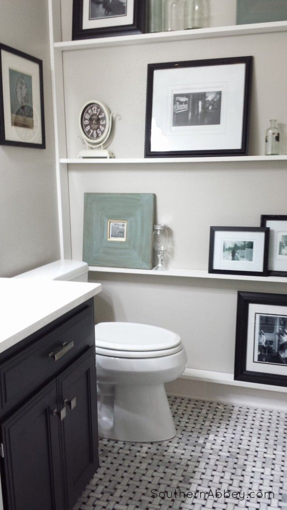 Neat idea - add a shallow display shelf for that wall in the bathroom. half bathroom makeover at Southern Abbey