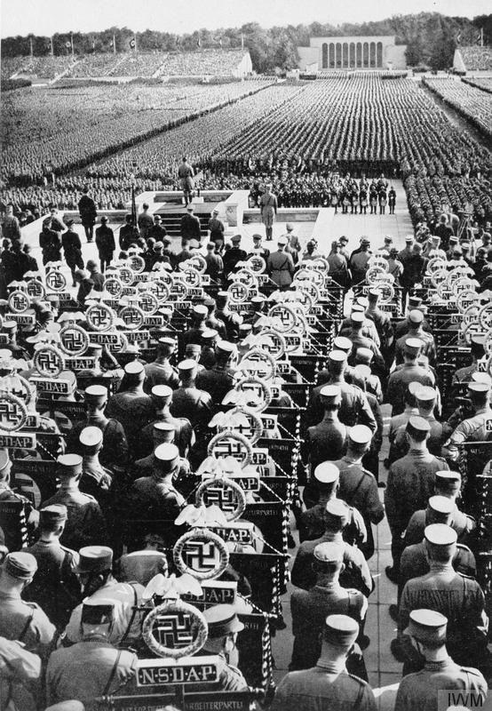 Adolf Hitler addresses the Nuremberg Rally during the ceremony of dedication of NSDAP standards, 10-16 September 1935.