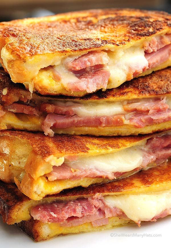 Monte cristo sandwich, ham, cheese spread with mayo and mustard then dipped in egg and fried like French toast