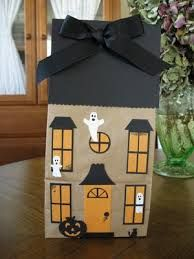 Awesome idea for a Halloween program. Haunted Houses made from brown paper bags