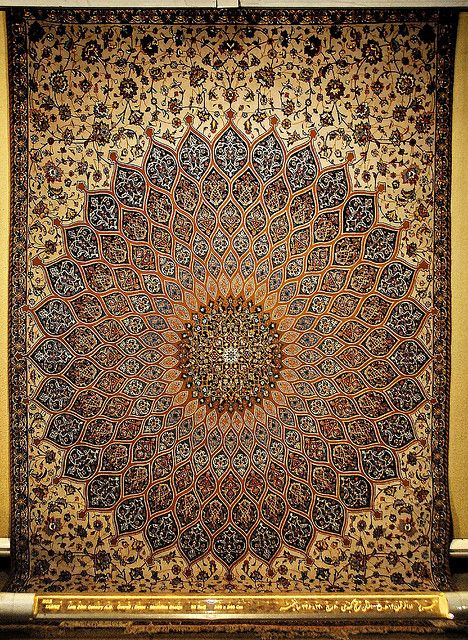 Iran Tehran -- Complex carpet weaving designs found in the Carpet Museum of Tehran resemble the mosaic patterns found on mosque cupolas