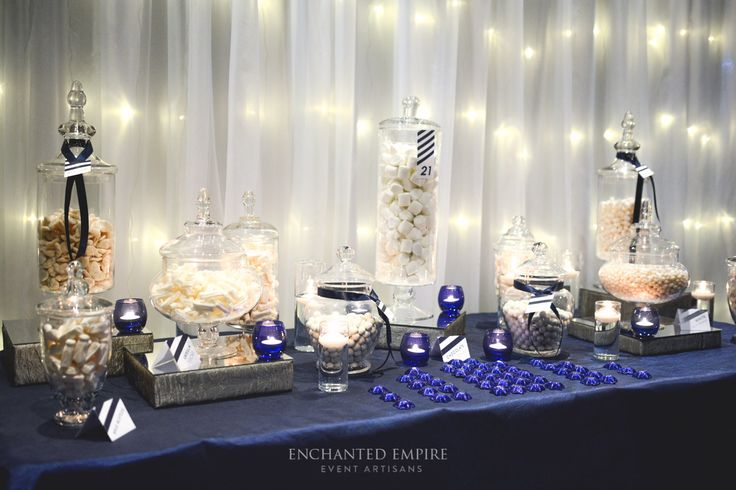 To celebrate a sentimental and milestone moment, our client wanted a bold + strong theme to this masculine Candy Buffet. Playing on the simplistic navy striped pattern and framed by a warm white fairy light backdrop with navy crushed taffeta linen, set the scene for this delicious feature. It was certainly a talking point for guests to enjoy and a great interactive element for this landmark occasion. Youtube: https://www.youtube.com/watch?v=jfTdxlo5k-s