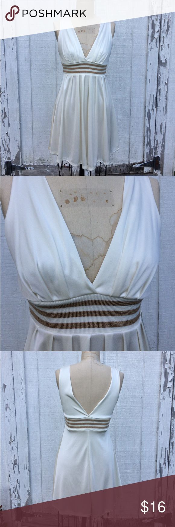 "💕SALE🐬Forever 21 Cream and Gold Dress Forever 21 stretchy poly Cream dress with deep v-neckline and elastic Sparkly gold and Cream striped waistband. Measurements: chest: 19"" across the front, waist: 15"" across the front, hips: 21"" across the front, length: 34.5"". In excellent condition Forever 21 Dresses Mini"