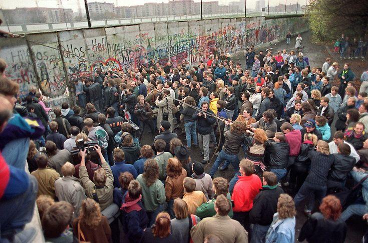 Tearing the Berlin Wall down, 1989.