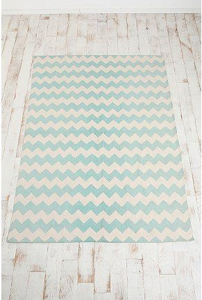 Not sure I want to invest in a chevron-patterned rug (it's so trendy!) but I like how the hues wouldn't dominate the small room we're working with. I'd consider this if it was gray.