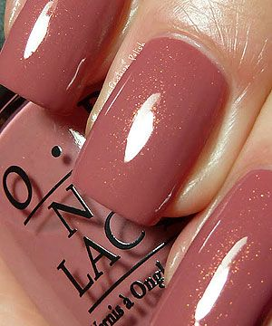 OPI Gouda Gouda Two Shoes, antique rosy brown or browny rose with, a pink/green/gold shimmer.