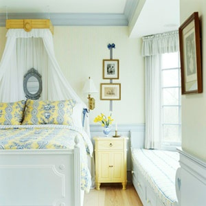Boxed-In  For a less lavish look, opt for a   more diminutive canopy that   cascades around a bed's   headboard. To create the look,   a wood valance was built to   extend from the wall. White   sheers were mounted to the   interior of the boxy valance.   The canopy ties in with the   room's country French style   and yellow and blue color     scheme.