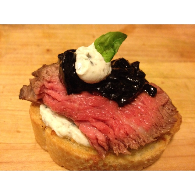 Peppered filet, balsamic reduced onion chutney, and herb creme on ...