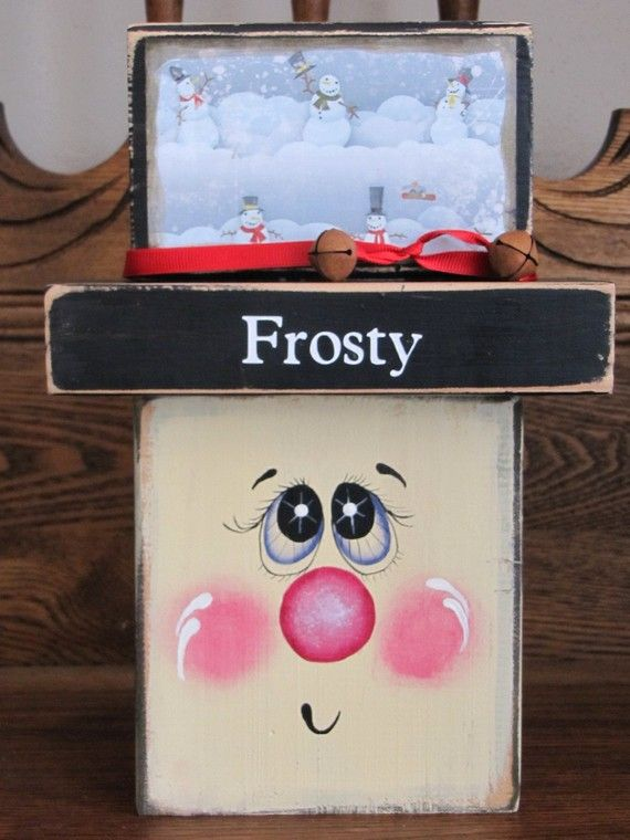 Block Head Snowman ~ by Kristie @ Punkin Seed Productions.  I did this using several different sizes of boards.  I left the hat all black and tied a red ribbon around the hat rim.  It is so cute.   and it was easy to make/paint.