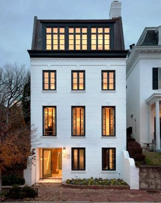 Georgetown townhouse curb appeal with painted white brick + black trim
