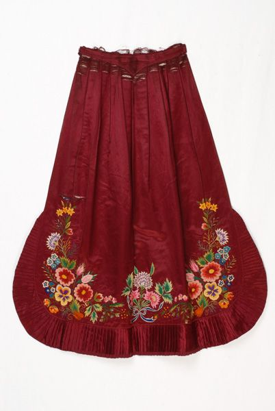 Satin apron in bright crimson colour, embroidered with multicoloured silk threads. An accessory of the festive female Vlach costume of the Metsovo region, Ioannina prefecture, Epirus, Greece © Lyceum Club of Greek Women