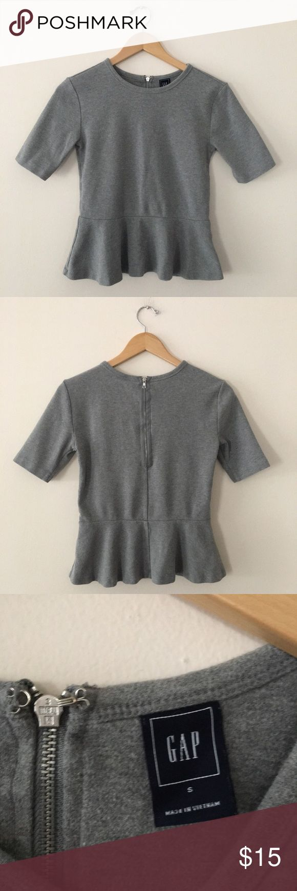 "GAP Cotton Peplum Shirt Gray peplum top with back zipper. Sleeves are longer than average T-Shirt sleeves and shorter than elbow sleeves. They hit right at the middle. 100% cotton. Length: 20.5"" Armpit to Armpit: 20.5"" GAP Tops Tees - Short Sleeve"