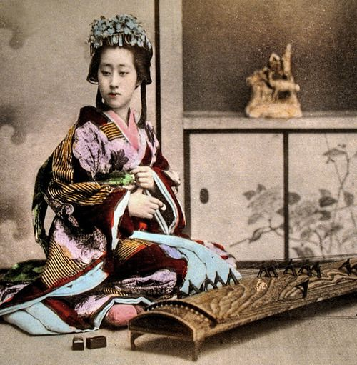Informal portrait of woman seated beside koto. Hand-colored photo, about 1880's, Japan. Image via ookami_dou of Flicker