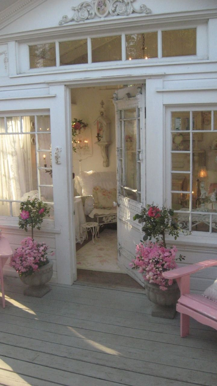 A pretty and welcoming entrance beckons visitors to enter this Victorian shabby chic themed cottage