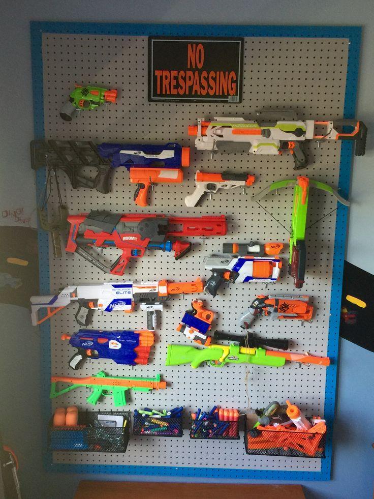 Nerf gun storage peg board. Project complete!! One happy boy! :)