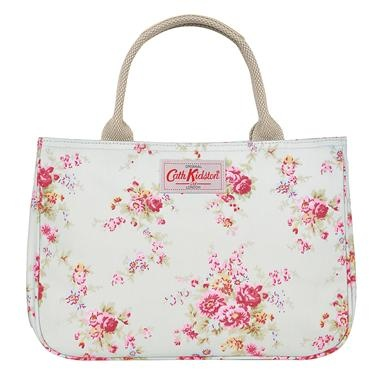 Make a statement with this lovely Washed Roses mini tote bag with contrasting Hampton Rose lining on a stone background. This spacious bag features sturdy webbing handles with brown leather trims.