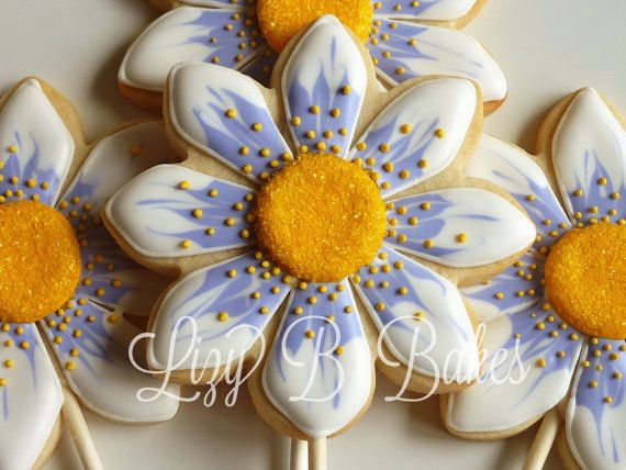 One Dozen Flower Cookie Pops by LizyBsbakeshop on Etsy, $48.00... I love how realistic looking these are! great favor idea for a bridal shower