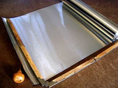Heavy Aluminum foil  7 times thicker than household foil but soft so it can be tooled, embossed and wrapped around a form. Great for long lasting holiday decor.  there are all sorts of heavy foils whimsie.com
