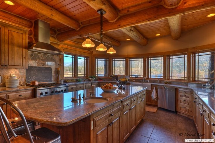 Wrap-around log home kitchen with large island view - I absolutely love this #kitchen