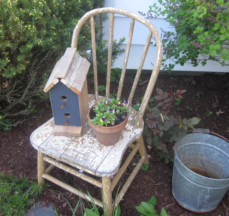 Old chair and birdhous