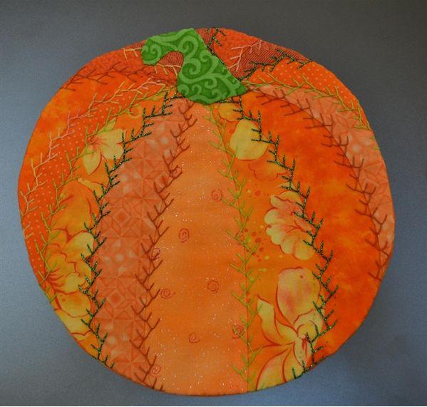 ~free pattern~ Pumpkin Crazy Quilt Mug Rug | Pellon® Projects