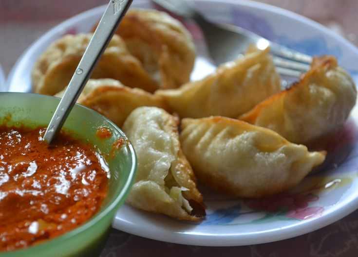 Deep fried beef momo and a hot chilli sauce on the side. For full blog on Eating in the Himalayas and Himalayan Food from Sikkim, Tibet and Nepal check our blog http://live-less-ordinary.com/southeast-asia-food/himalayan-food-eating-himalayas