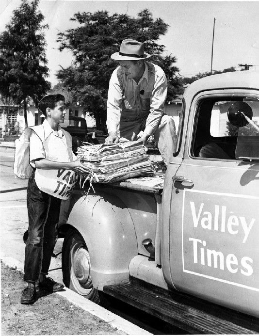 Thirteen-year-old Richard Petri, a Burbank newspaper delivery boy, picks up the Valley Times for his morning route, 1949.  San Fernando Valley Historical Society. San Fernando Valley History Digital Library.