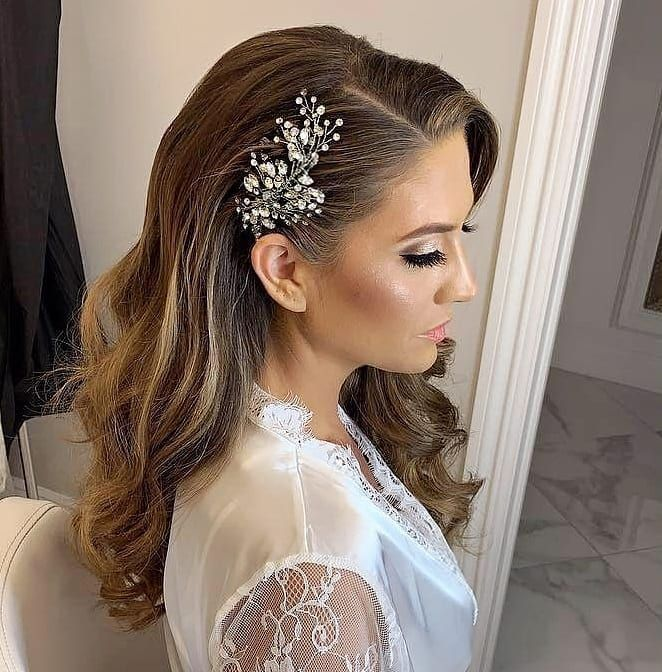 Lovely bride Olivia getting ready to start her wedding day.Crystal comb by Bridal Styles Boutique. Robe by Elle New York.