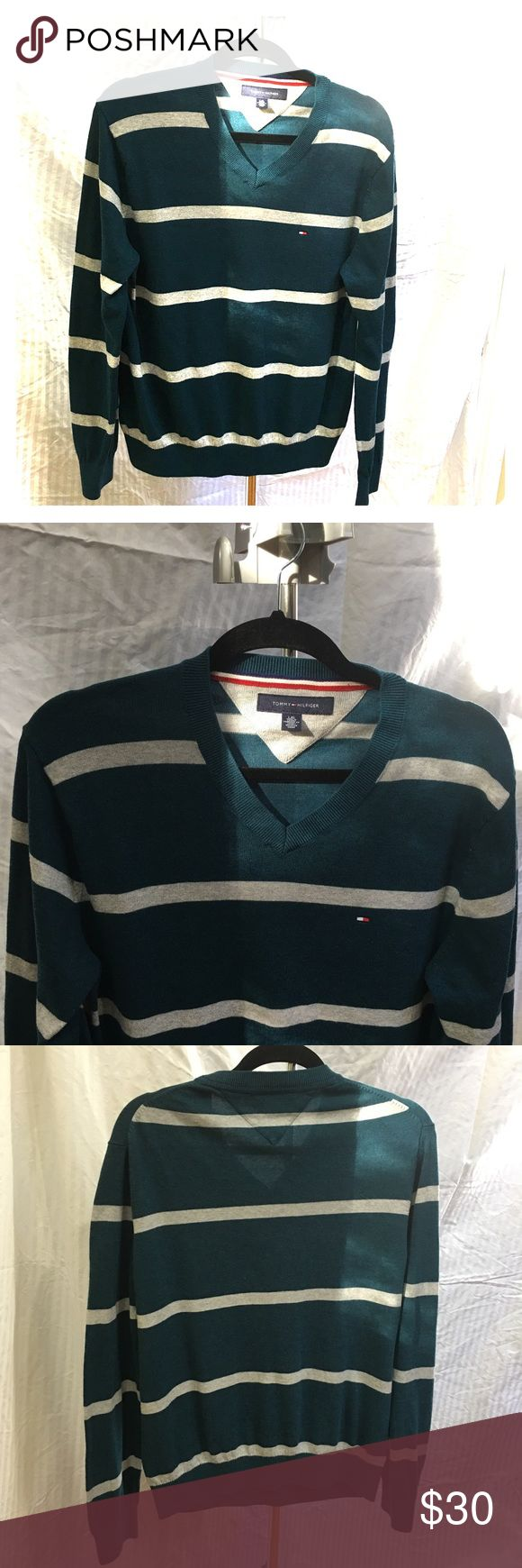 Men's Tommy Hilfiger sweater size Lg dark teal Men's Tommy Hilfiger sweater size Lg dark teal and gray. Only worn a few times so in great condition. Fabric is 60% cotton and 40% modal. Nice looking sweater Tommy Hilfiger Sweaters V-Neck