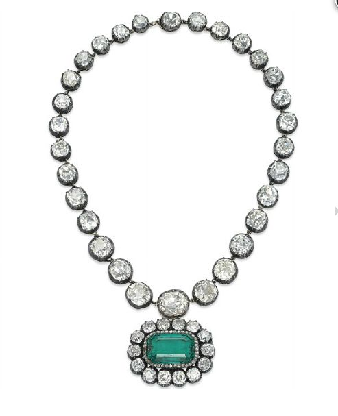 AN ANTIQUE EMERALD AND DIAMOND NECKLACE   Designed as a riviere necklace composed of thirty graduated old-mine diamond collets, suspending at the front a later added pendant centering upon a cut-cornered rectangular emerald, in an old-mine diamond surround, mounted in silver and gold, necklace mid-19th Century, pendant late 19th Century, necklace 38.0 cm, pendant 3.9 cm