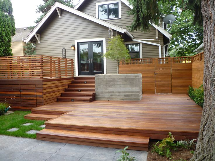 horizontal cedar fence deck in Deck Traditional with brown exterior beige molding