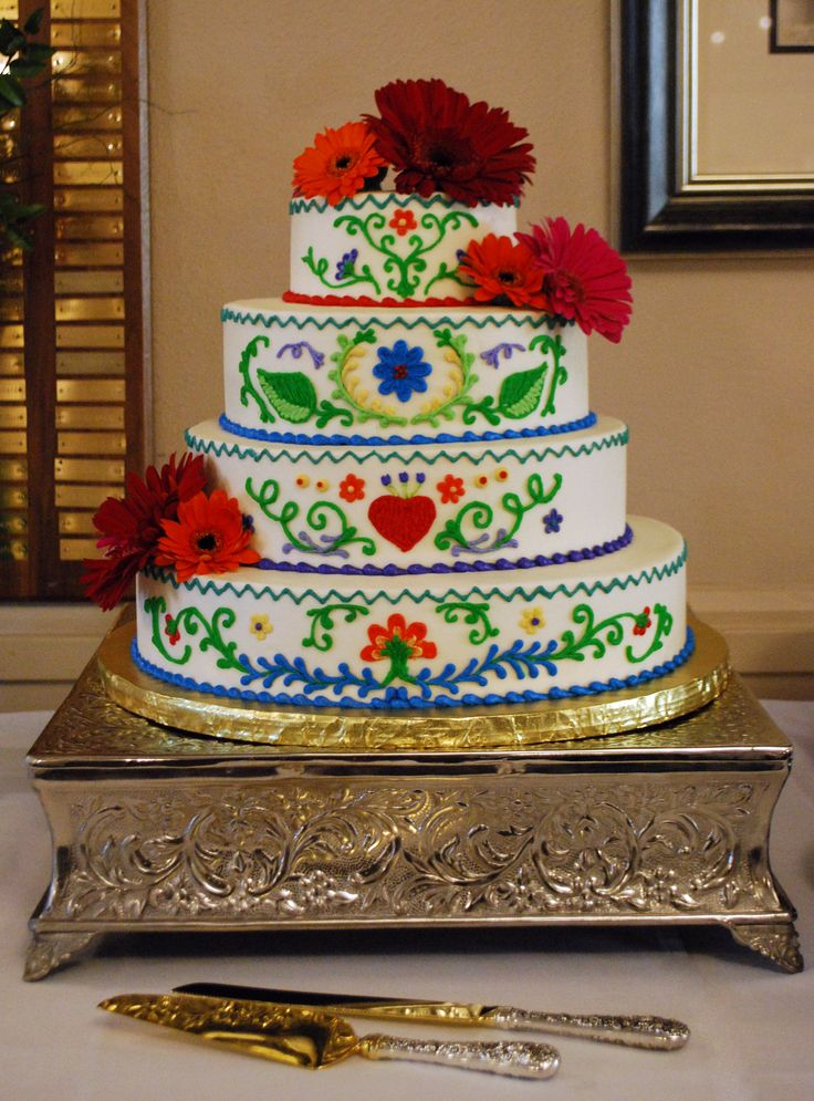 Mexican Embroidery inspired wedding cake. Bold and vibrant colors enhance the design to celebrate the happy occasion and the couple's heritage. Top Tier Wedding Cakes, Ashland, Oregon