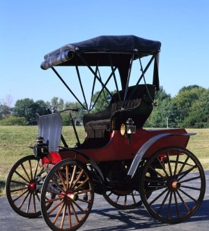 """1900 St. Louis - The St Louis Motor Carriage Company was started by George Preston Dorris and John French in 1898. In 1900 John French drove a St Louis from St Louis to Chicago for the first time in an automobile. The company moved to Peoria, Illinois in 1905 as Dorris left to create his own marque. The company lasted until 1907. This car definitely fits into the 'horseless carriage"""" category. It weighs only 390 lbs. w/ a  one cylinder, water-cooled engine and a top speed of 18 mph."""