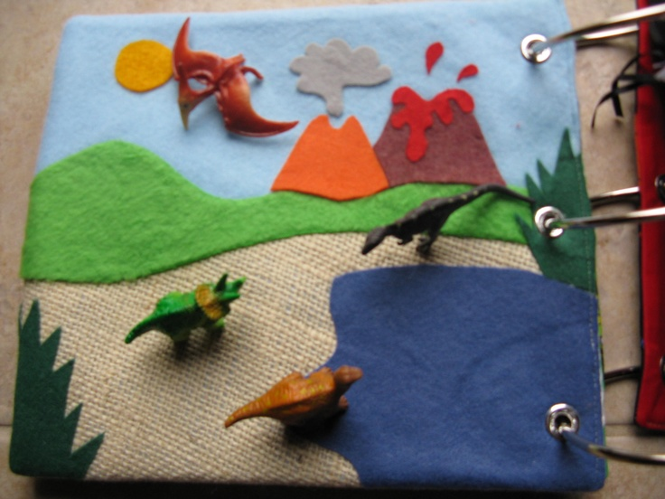 Dinosaur landscape used with purchased dinos kept in a bag on a neighboring page.