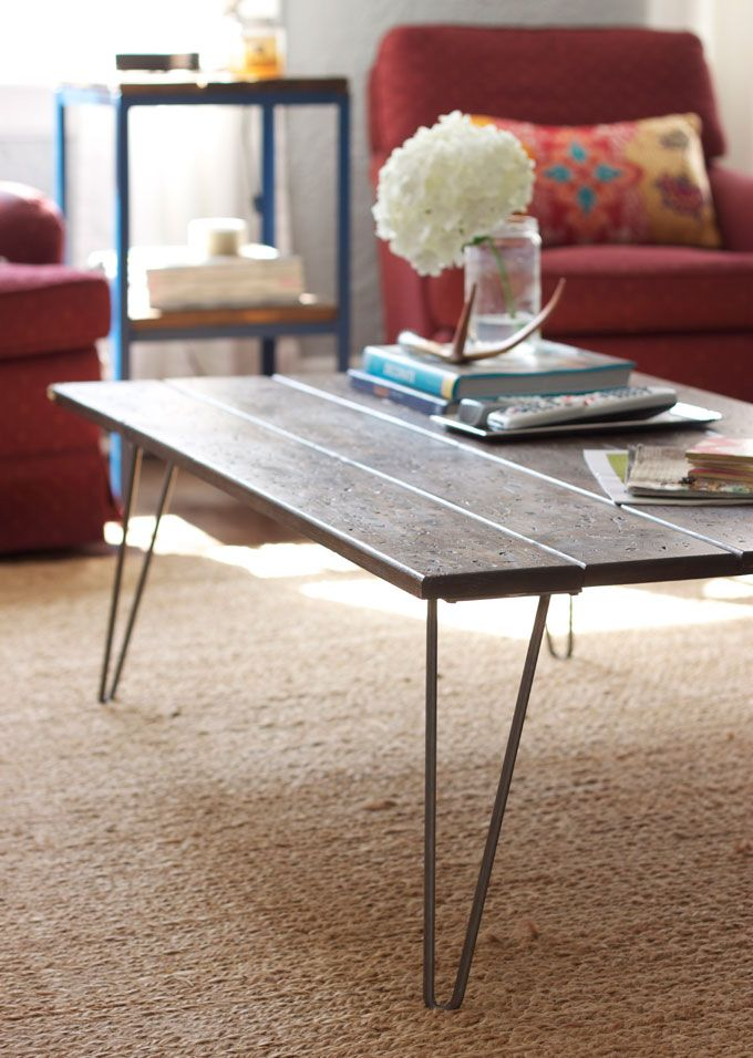 Make a simple coffee table by adding hairpin legs to a piece of wood or old door — via @TheFoxandShe