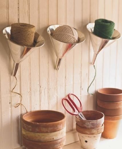 Funnels! Yes, I said funnels for yarn/twine/more twine! Ivory Bird: Craft Room Storage Ideas #Storage #Knit