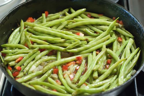 Fresh green beans from the garden into YUMMY side with bacon, onion, garlic, chicken broth.