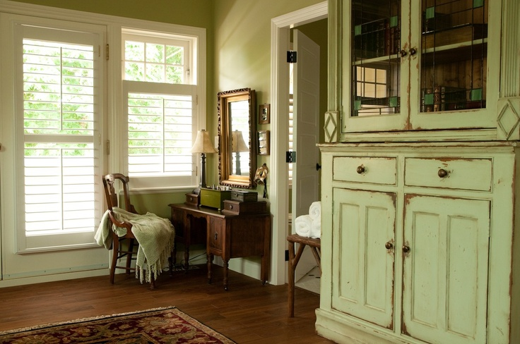 This antique inspired hallway, painted in Heidi's favorite, Benjamin Moore Georgian Green, is so inviting